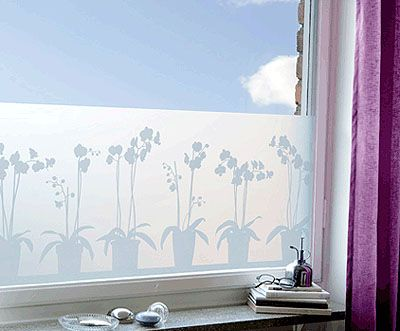 Use designed window film instead of cafe curtains to let in more light and improve bad