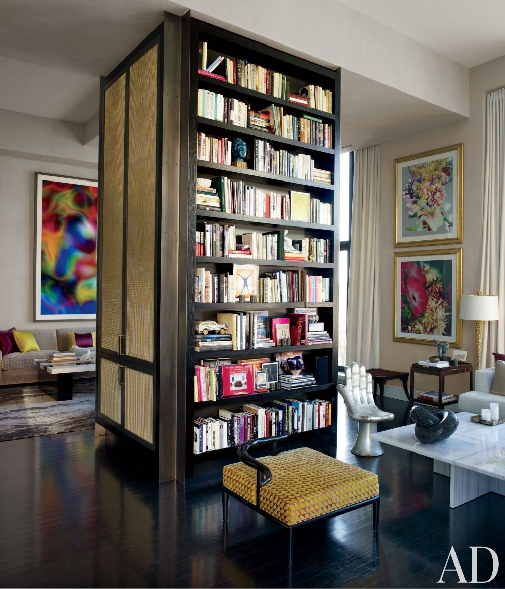 Designer jamie drake 39 s new york living room features a floor to ceiling cabinet with storage and for Floor to ceiling cabinets for living room