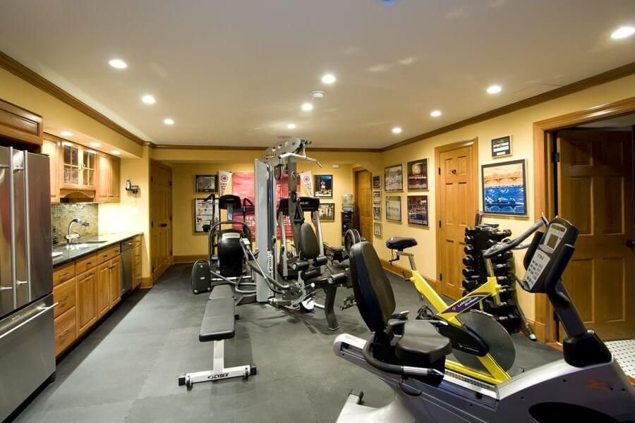 Exceptional Enclosed Home Gym In Basement Of Home With Cardio Equipment And Weight  Machines. Small Kitchen In The Room As Well.