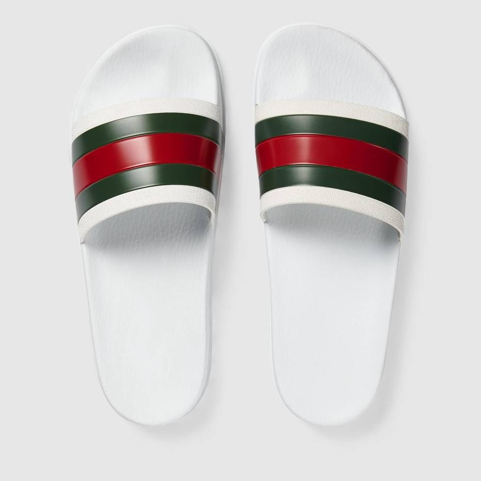 5cab392dcaf Shop the Web slide sandal by Gucci. A casual rubber slide sandal with our  Web detail.