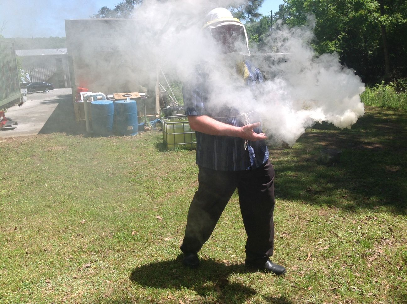 Host Wayne Atchison Fires Up The Smoker To Calm The Bees Buzz