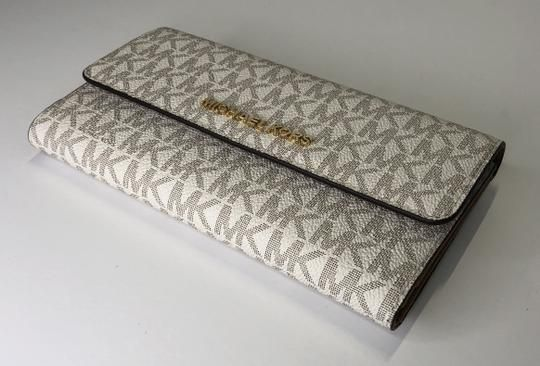 0f917bf6d4aa Michael Kors Signature Mk Vanilla Jet Set Travel Large Trifold Saffiano Leather  Wallet. Free shipping