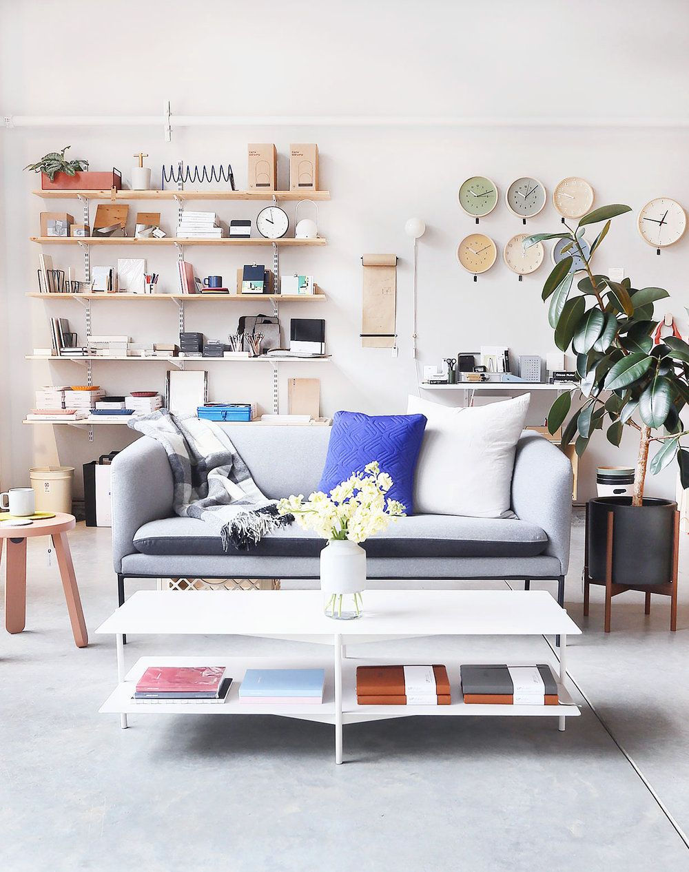 Neatly stacked and organized home accessories and furniture with a scandinavian modern minimalist style these accessories can be found at port of raleigh