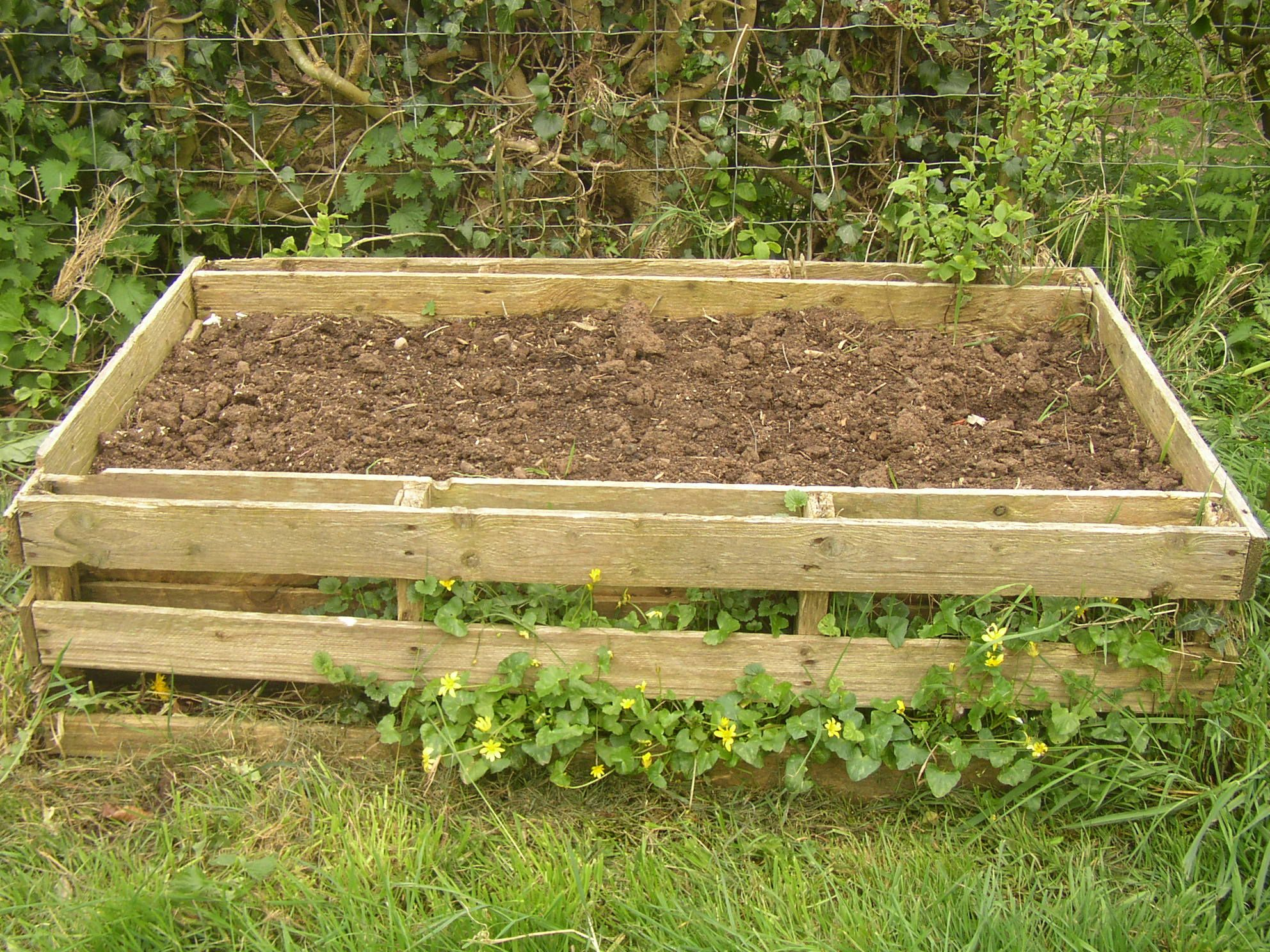 Pallet planter planters raised bed and gardens for Pallet veggie garden