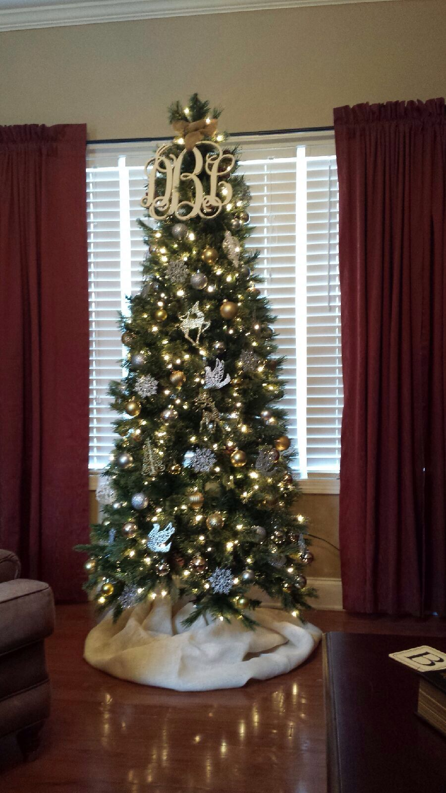 Silver and gold Christmas tree with monogrammed topper and