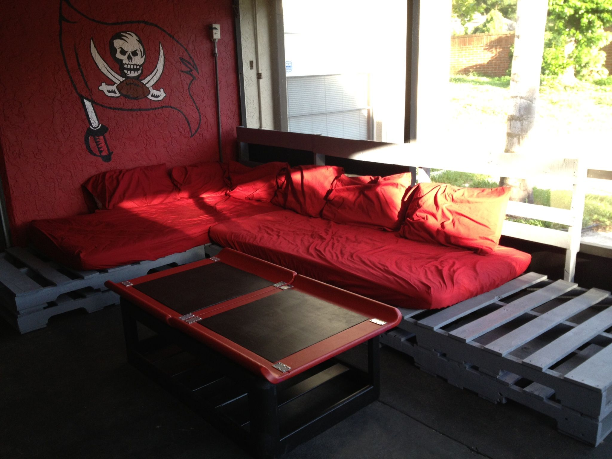 Recycled wood pallet L shaped couch on my Buccaneers themed porch