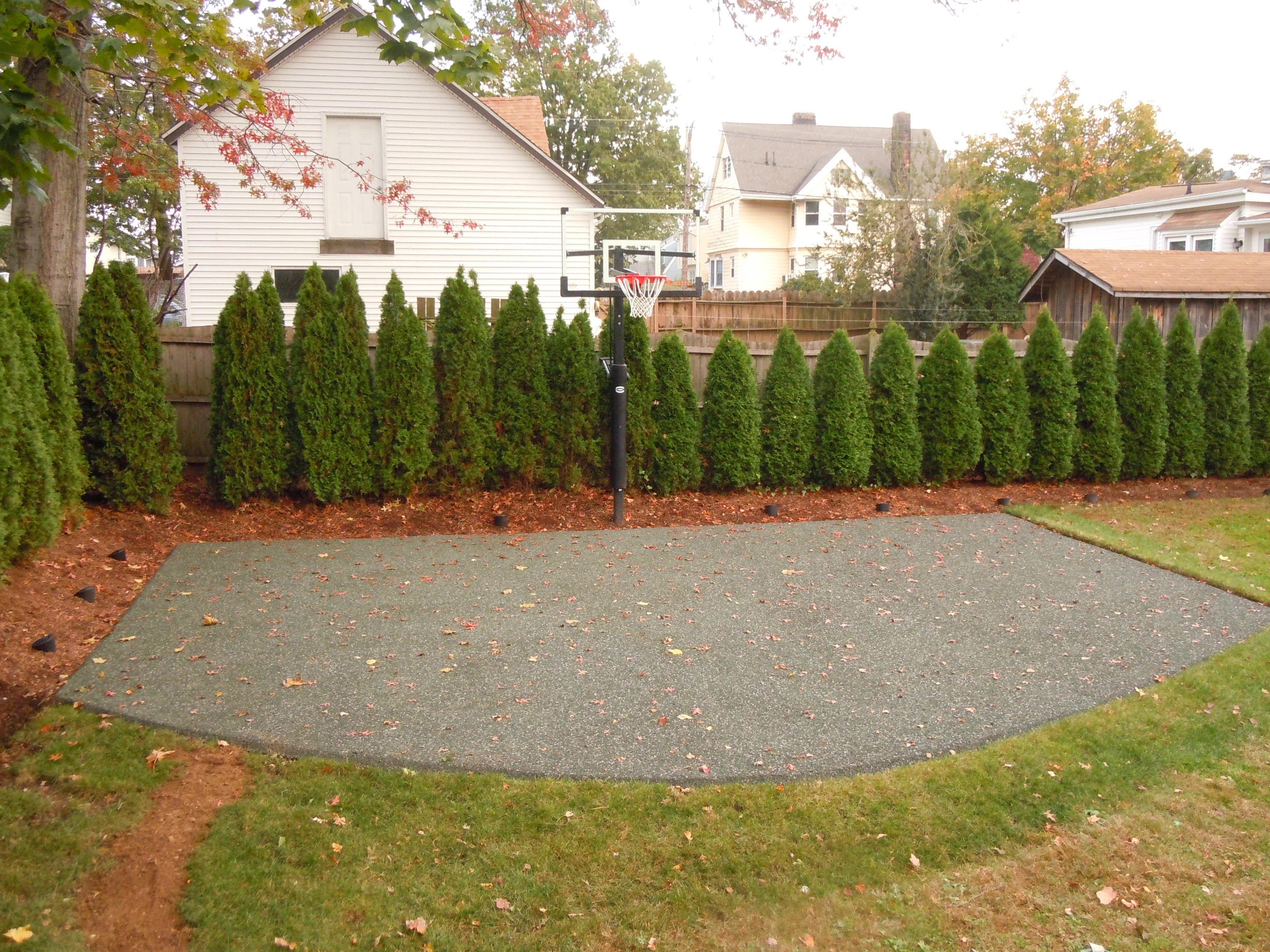 basketball court rubberized permeable paver backyard