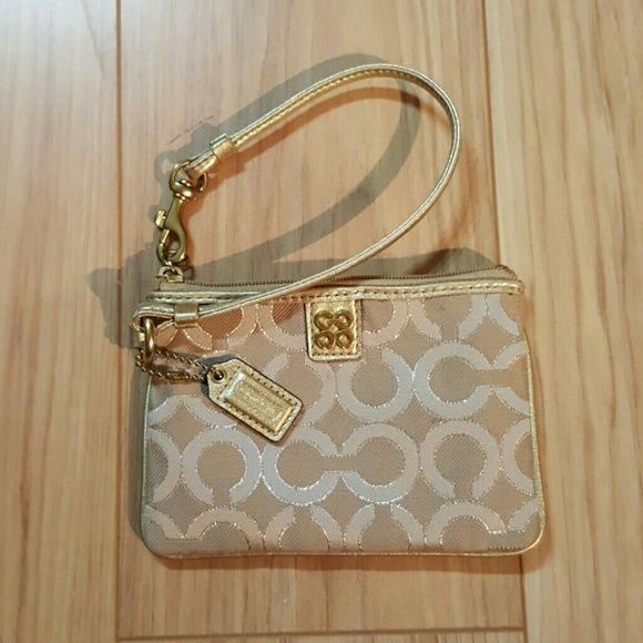 Gold Logo Coach Wristlet Gold logoed Coach wristlet with dark pink interior lining.  Great condition, no imperfections. Coach Bags Clutches & Wristlets