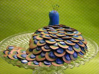 No Ordinary Cake: Peacock Cake_2_    A carrot cake is decorated with borrowed feathers. Peacock was made yesterday when my grandparents came to visit. It's always nice to guests and it is especially nice with an excuse to bake a cake!  The cake is greased up with a dangerous delicious cream cheese frosting. Feathers and head are made of fondant which is painted with bronze and pearl shimmer. Everything can be eaten except the small feathers on the bird's head.