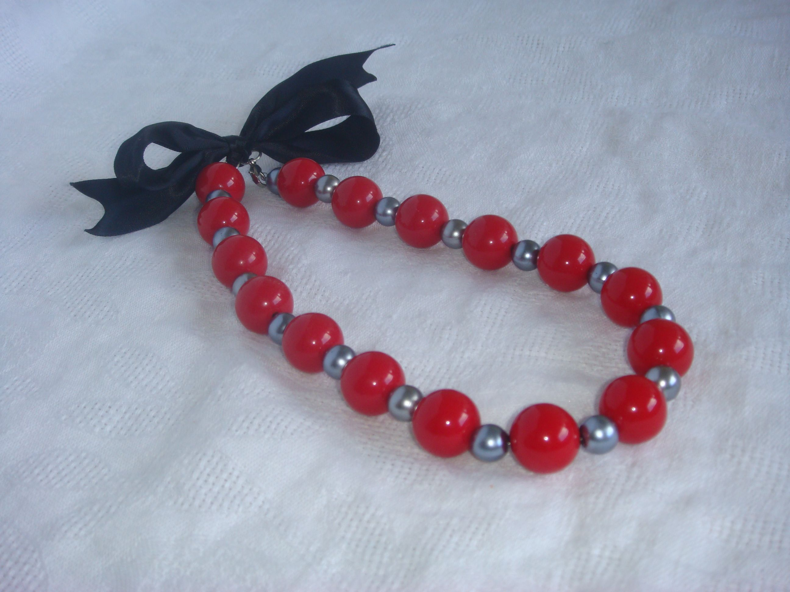 red-grey necklace with black bow