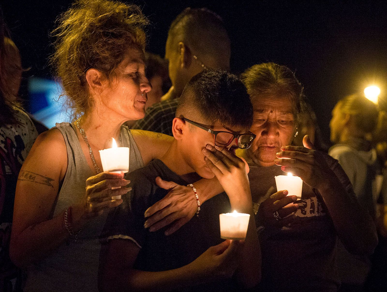 The Latest 2 men who pursued gunman attend shooting vigil
