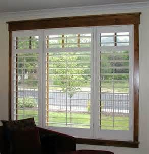 Darker Trim With A White Shutter Adds A Great Decorative Detail Wood Window Trim Farmhouse Window Trim White Shutters