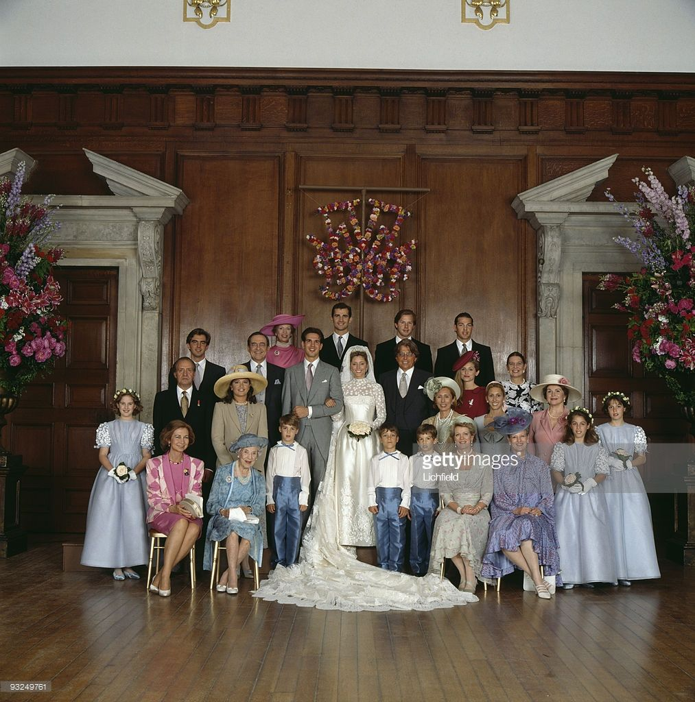 Royals pose at hampton court palace after the wedding of crown
