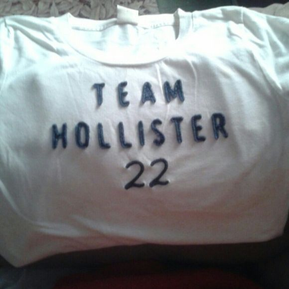 White Hollister Tshirt Blue fabric lettering. Good used condition.. Size Medium. Hollister Tops Tees - Short Sleeve