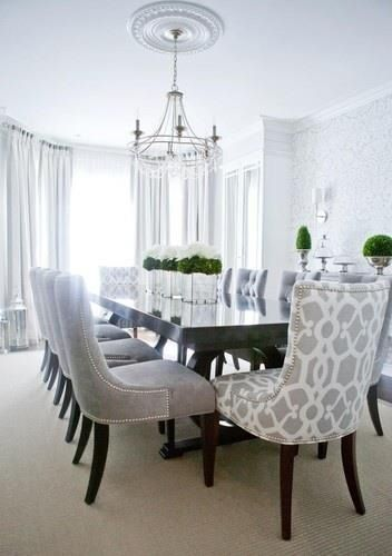 Dining room. love the different chairs at the ends