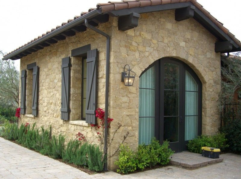 Tuscan house with limestone material black painted wooden windows ...