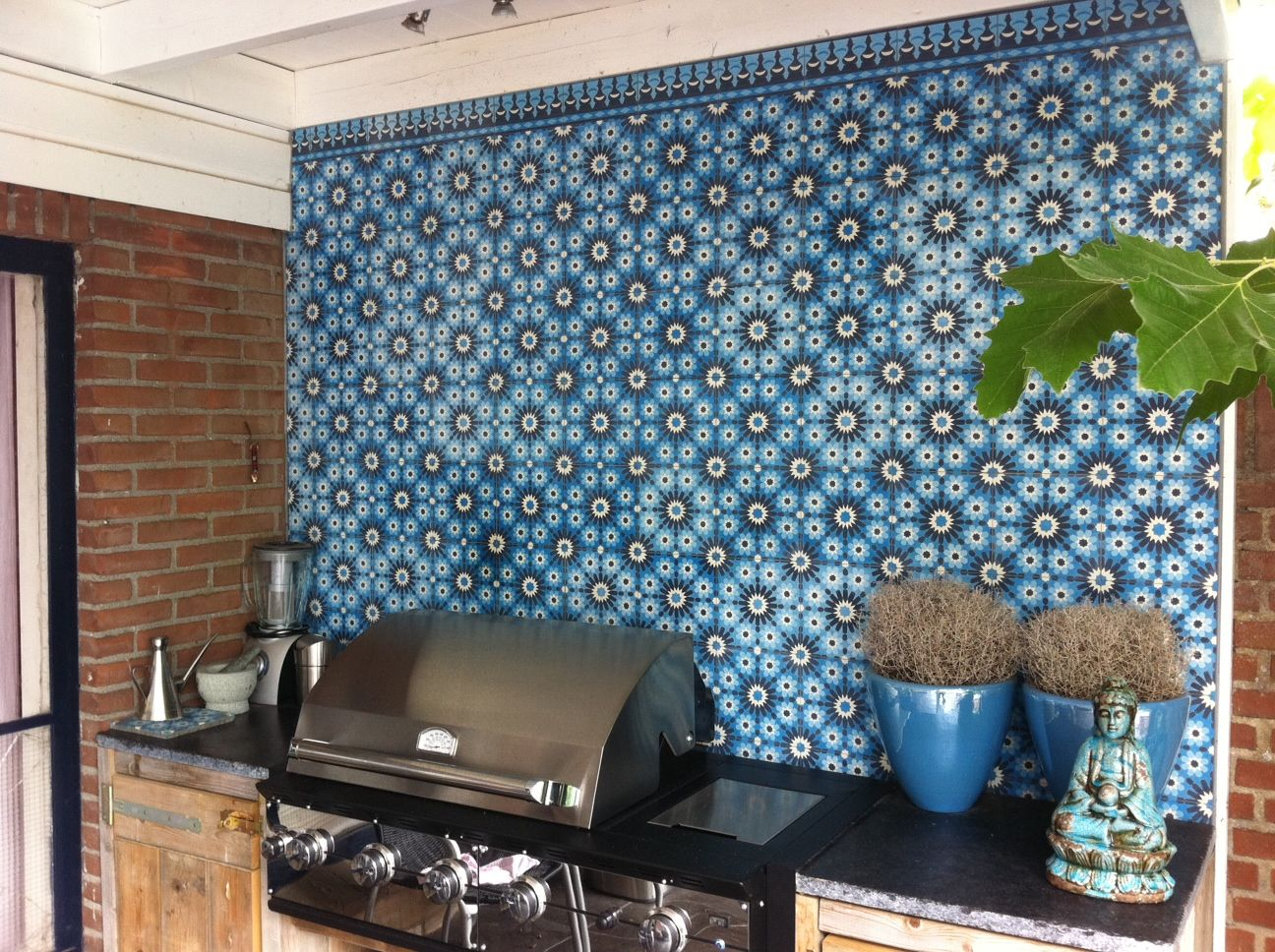 Outdoor kitchen with cement tiles (Azule 13) on the wall. Morocco ...