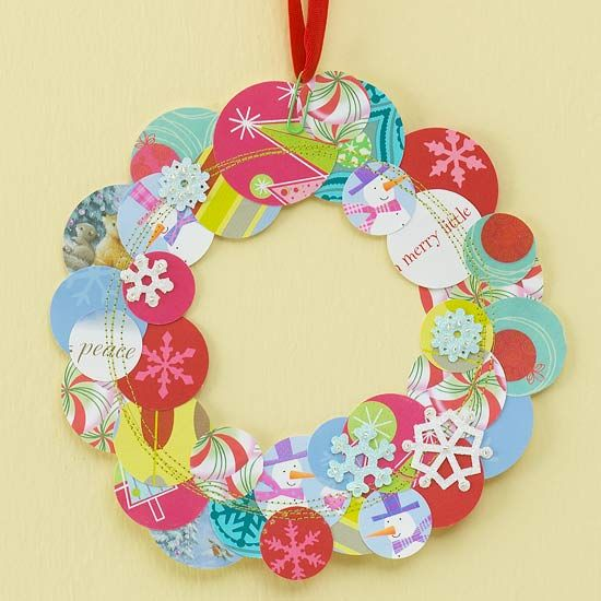 Greeting Cards Wreath—Select a palette of coordinating hues to create a whimsical wreath. Cut greeting cards into different-size circles. Arrange the circles into a wreath shape, overlapping as desired. Secure with crafts glue. Machine-stitch over the top using coordinating or contrasting thread. Attach a ribbon to the wreath with a colored paper clip and hang.