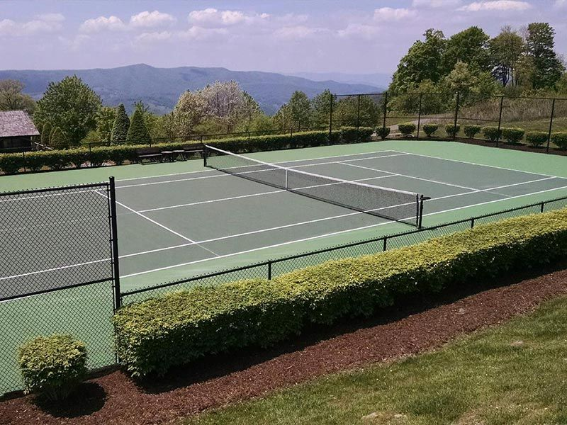 Stunning view of a newly resurfaced tennis court at