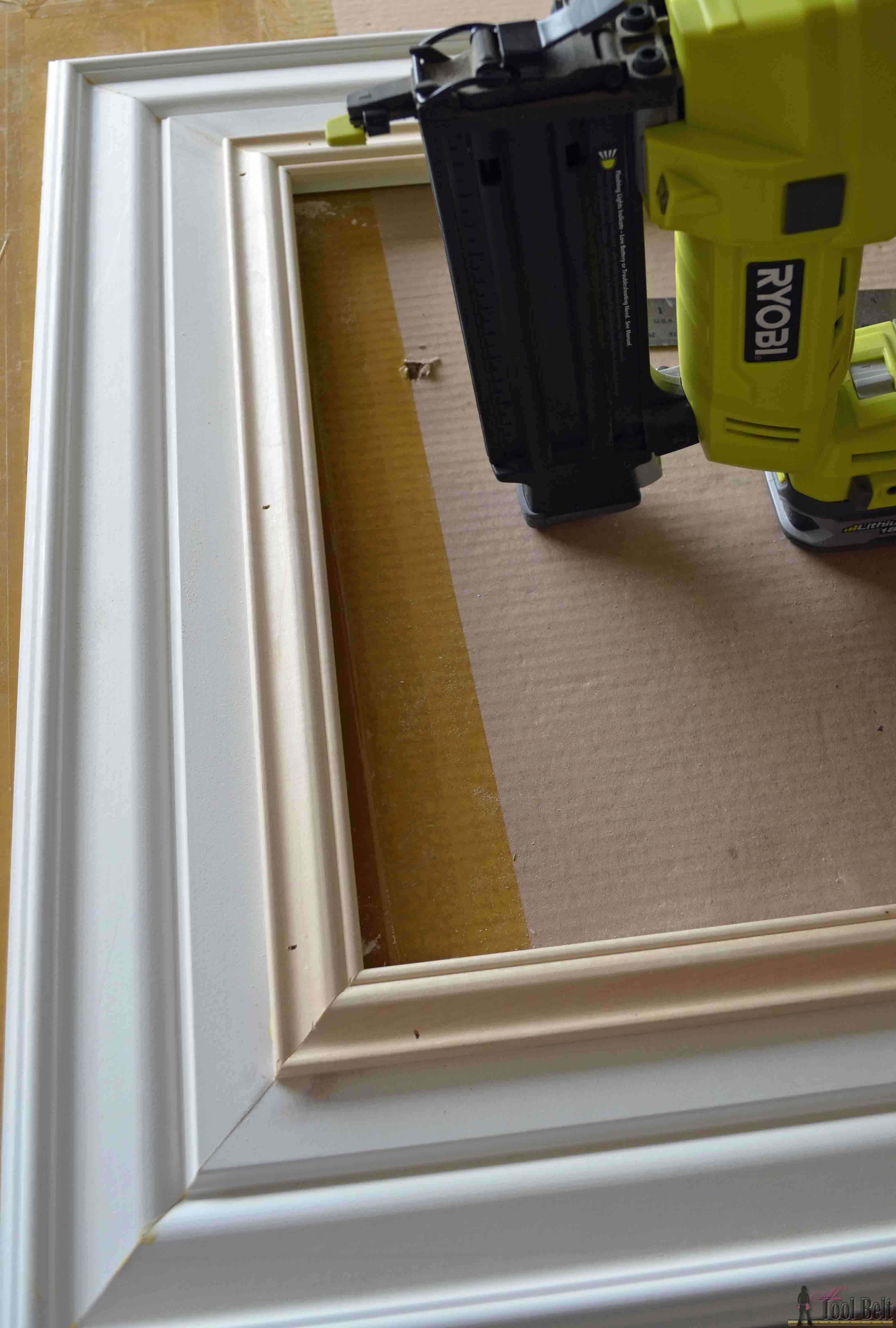 Home made pictures frames out of wood trim.