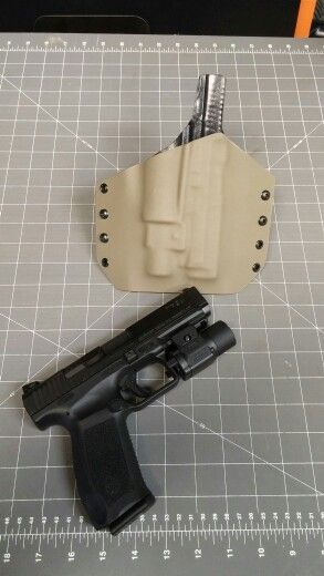 Our defcon2 holster for a Canik tp9sa with a tlr3 flashlight