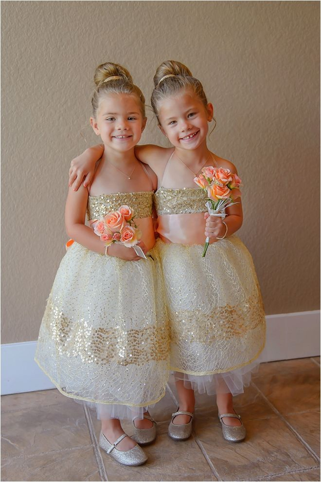 Adorable flower girls wearing matching sequin tulle dresses ...