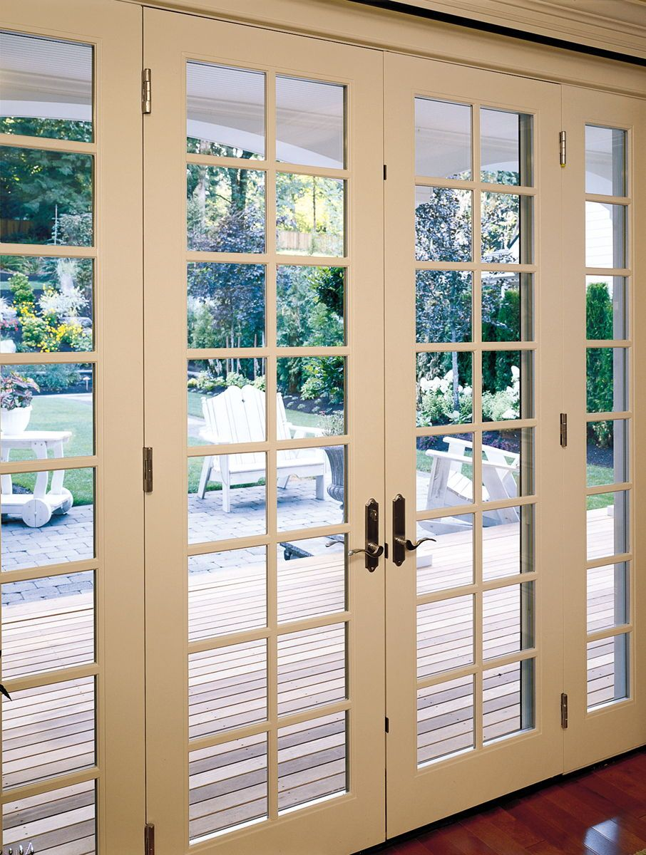 French Patio Doors With A Classic Look The Colonial Grids And Elegant Hardware Can Make A Statement In A French Doors Exterior French Doors Patio French Doors
