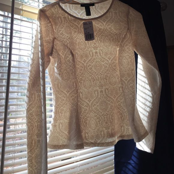 Lace peplum top Can not see through it. Never worn Tops