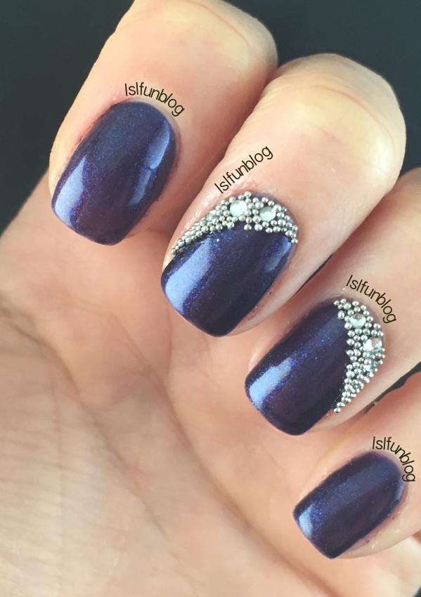 navy blue and crystals gel nail