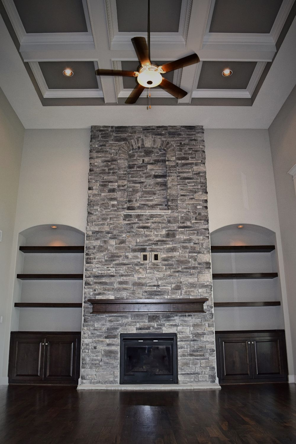 2 story great room coffered ceiling stone fireplace for Interior fireplaces designs