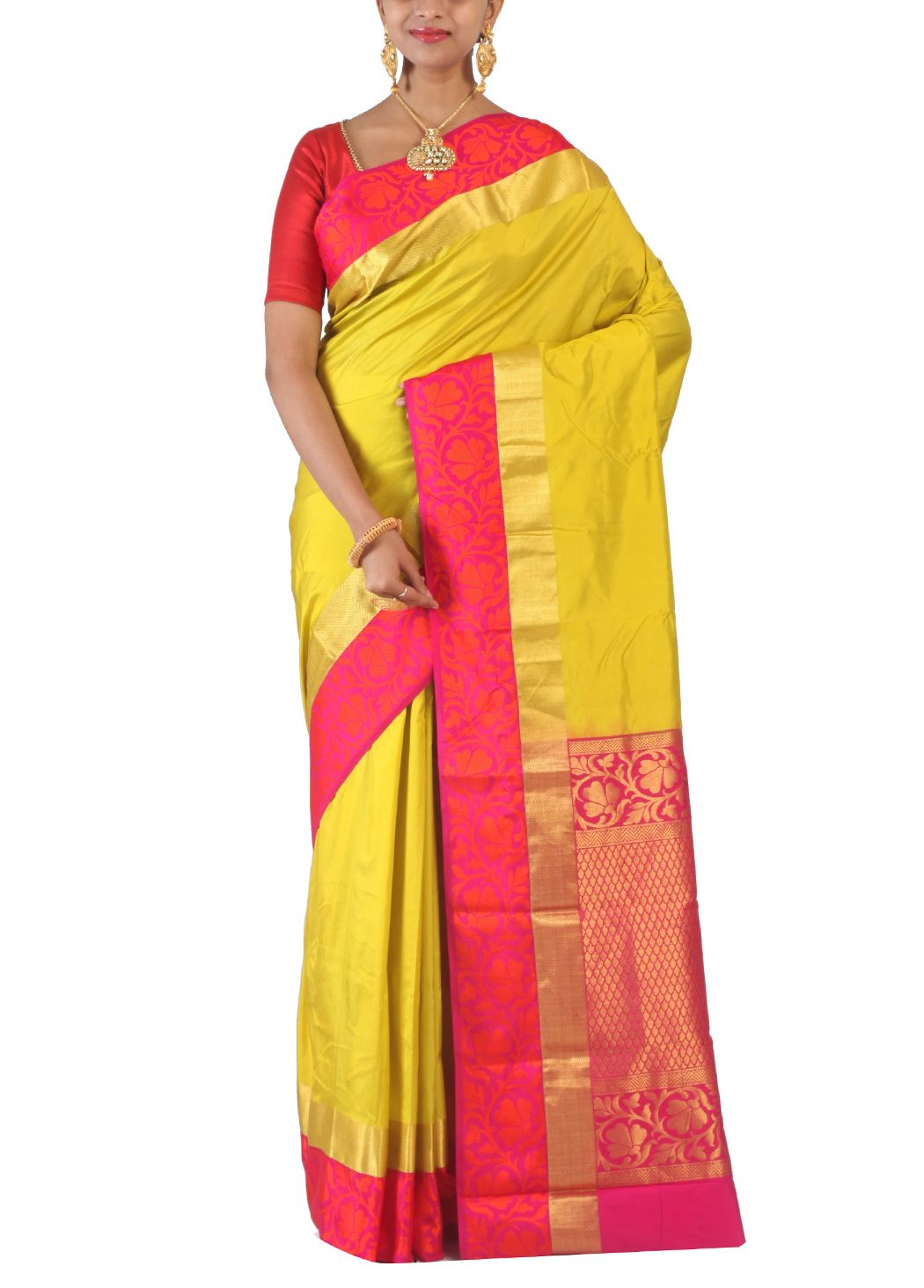 Yellow Green Blended Kanjivaram Silk Saree Features Plain Texture Which Is  Enhanced With Contrasting Zari And