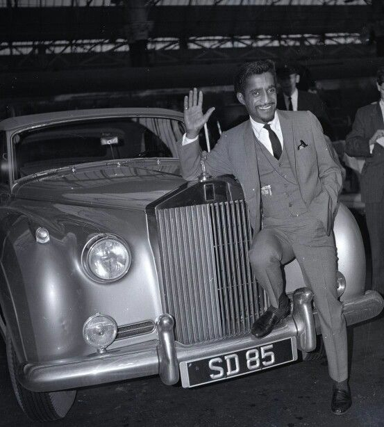 1961: Sammy Davis Jnr with his new Rolls Royce at Piccadilly Station, Manchester, during a visit on October 9 1961.