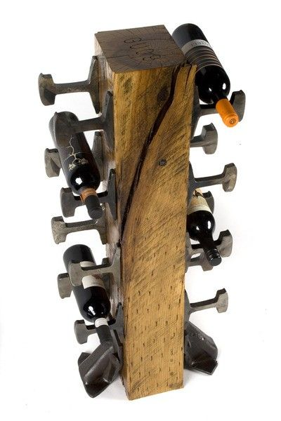 This wine rack is made from old train track parts.