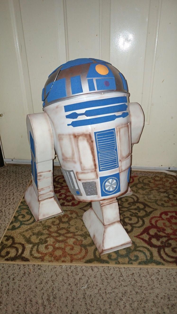 Homemade r2d2 out of a trash can with trifold posterboard