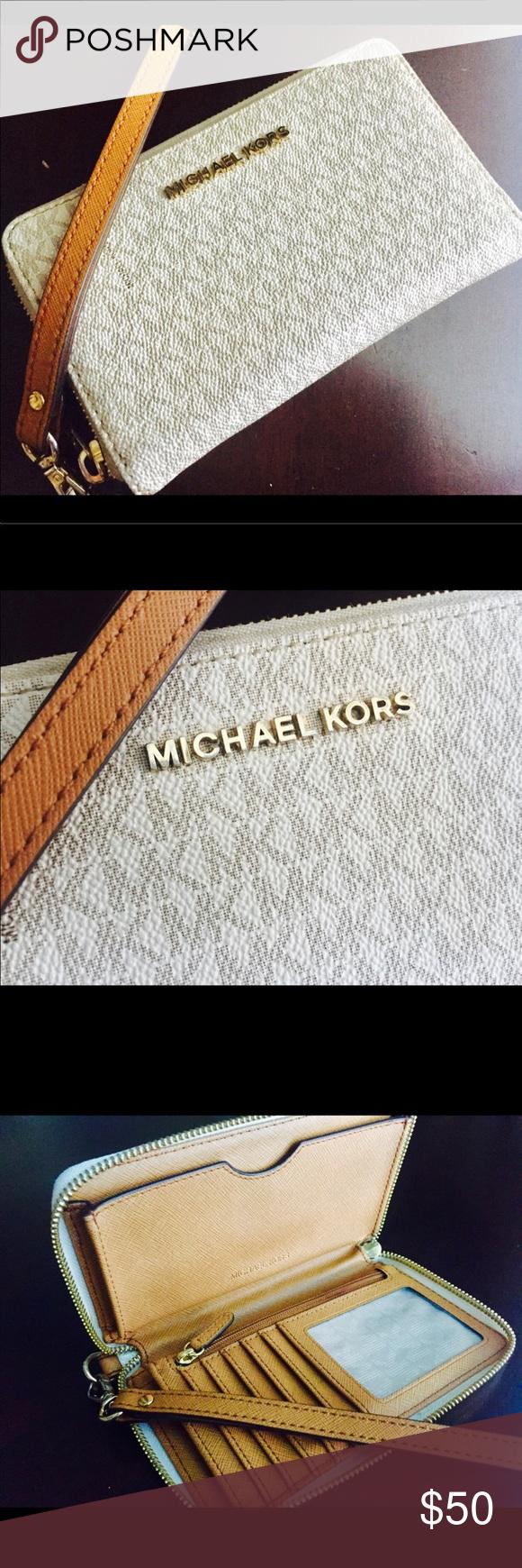 7b3373f01330 Michael Kors Logo Smartphone Wristlet This Michael Kors wristlet in white,  dine in the signature