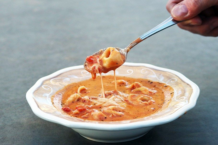 Creamy Tomato Tortellini Soup - a simple, delicious soup that is perfect for a cold winter evening!
