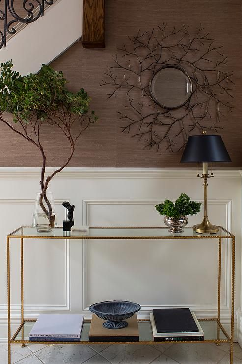 Attractive Amazing Foyer Features A Staircase Wall Clad In Brown Grasscloth And  Wainscoting Lined With A Glass