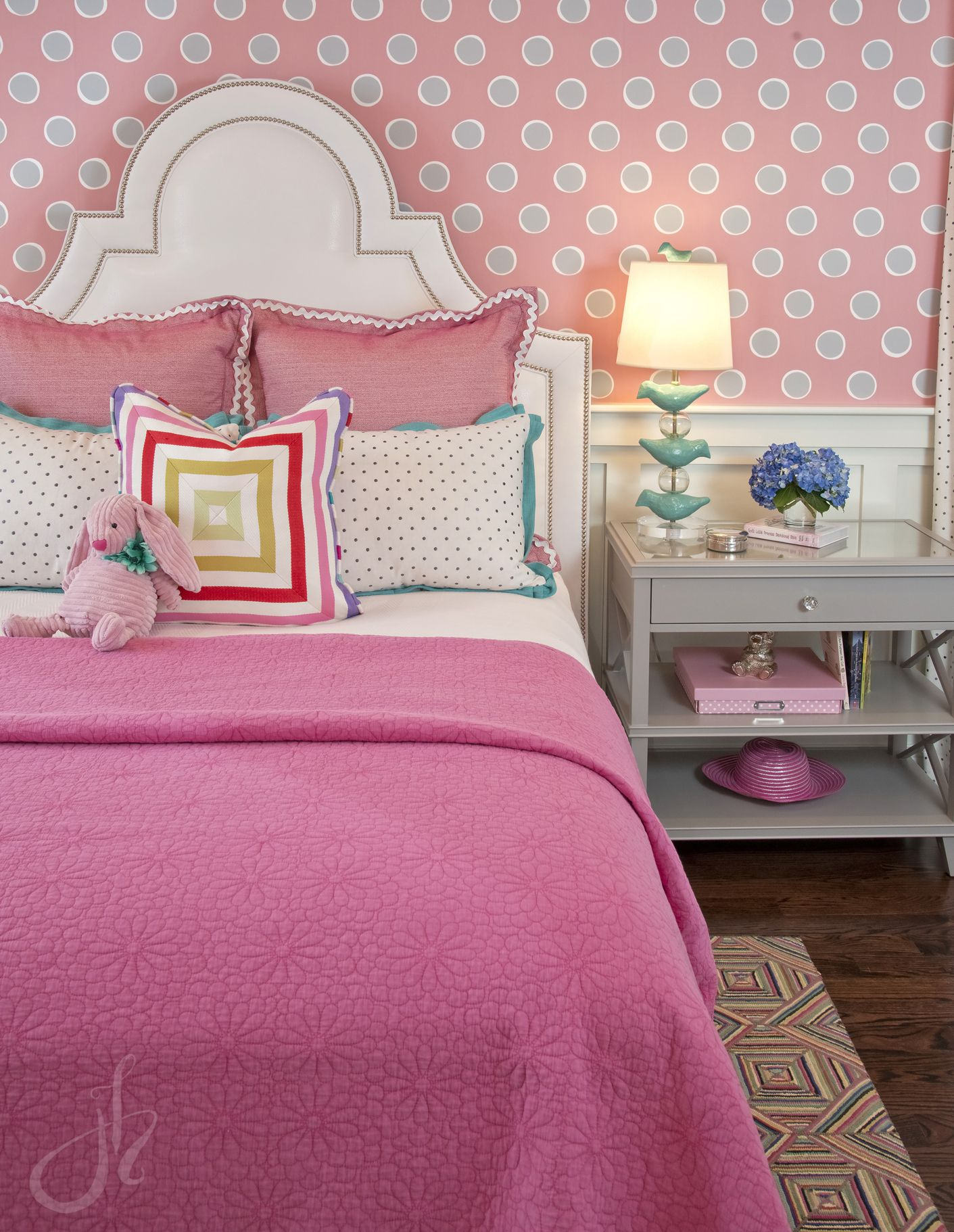 Girls bedroom Upholstered headboard Leather upholstered headboard Pink polka dot Serena and Lily wall paper Stray