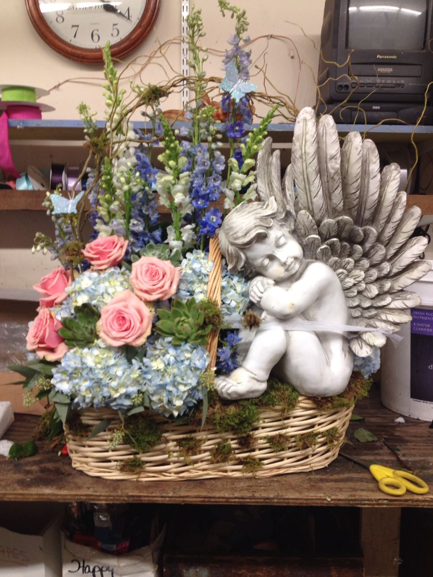 Basket of flowers and keepsake angel for a wake or funeral basket of flowers and keepsake angel for a wake or funeral izmirmasajfo