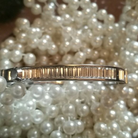 Michael Kors Bracelet Beautiful Micheal Kors bracelet. Great condition with exception of missing one of the decorative tabs - see 3rd photo.  Doesn't affect the functionality of the bracelet.  If you have a way to repair it, this is a great deal! Michael Kors Jewelry Bracelets