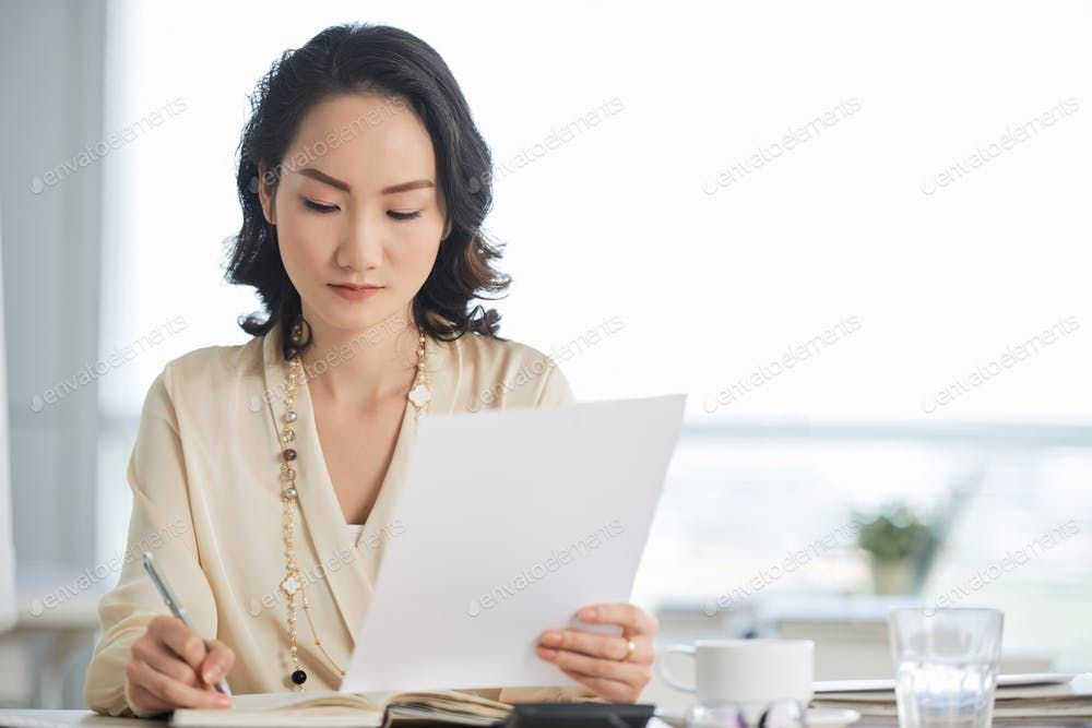 Female entrepreneur busy with work By DragonImagess photos