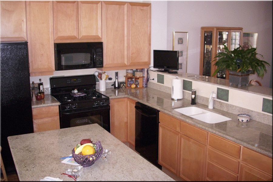maple cabinets and a light grey granite countertop. The ... on Light Maple Kitchen Cabinets With Granite Countertops  id=77899