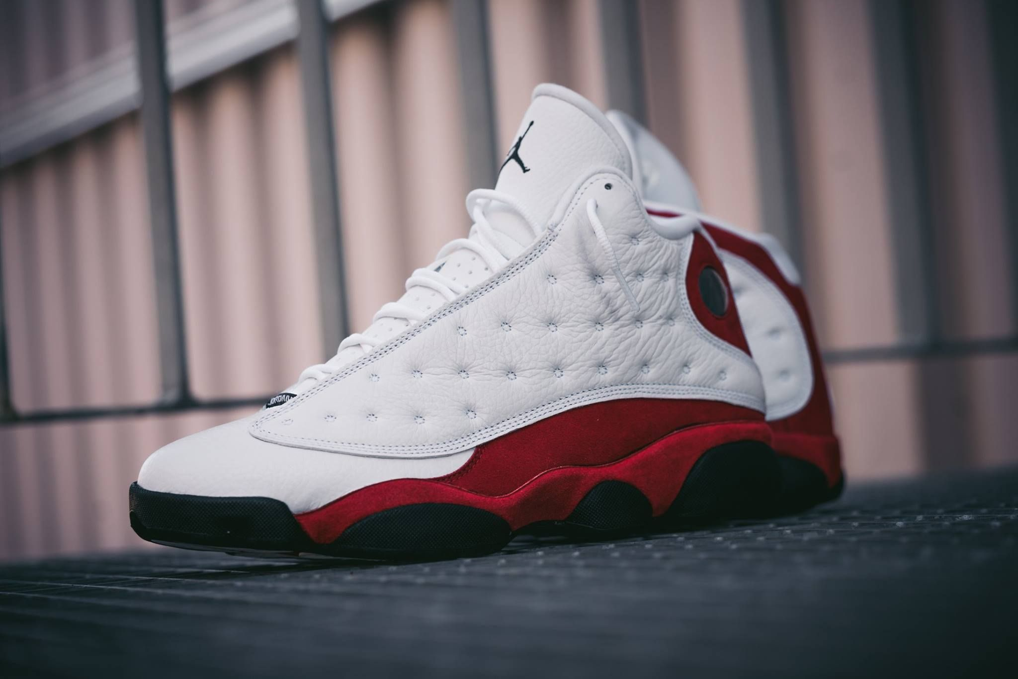 The Air Jordan 13 White True Red 2017 edition is showcased in another detailed look. Find it at select Jordan Brand stores on Feb. 18th.