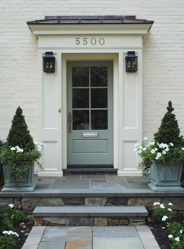 """Design by Loi Thai. Front door is painted Farrow & Ball's """"Blue Gray"""" #91; exterior is painted in Benjamin Moore Linen White., planters"""