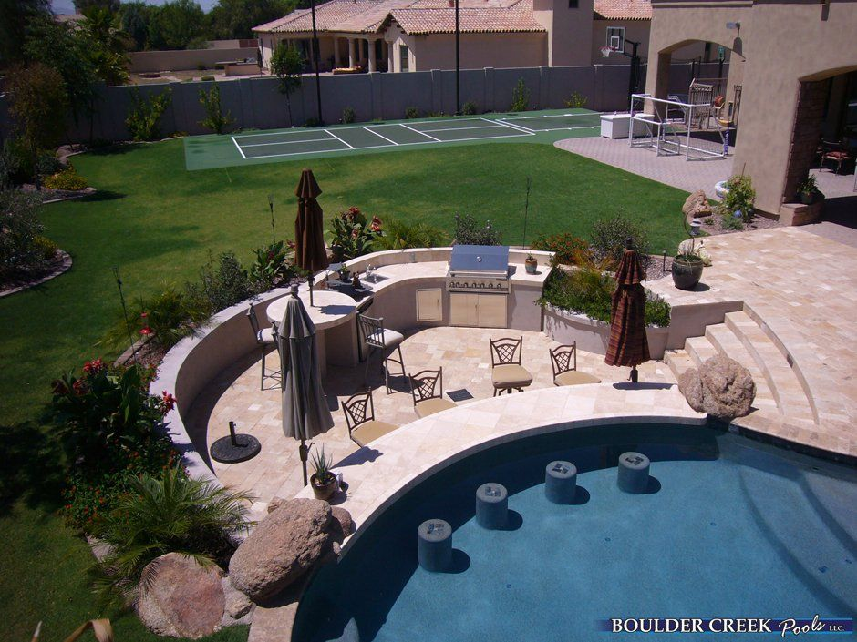 Outdoor kitchen pool sunk down jc sunken outdoor kitchen for Pool design swim up bar