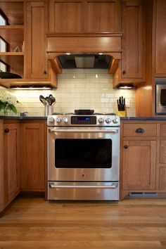 Download Wallpaper Oak Kitchen Cabinets With White Backsplash