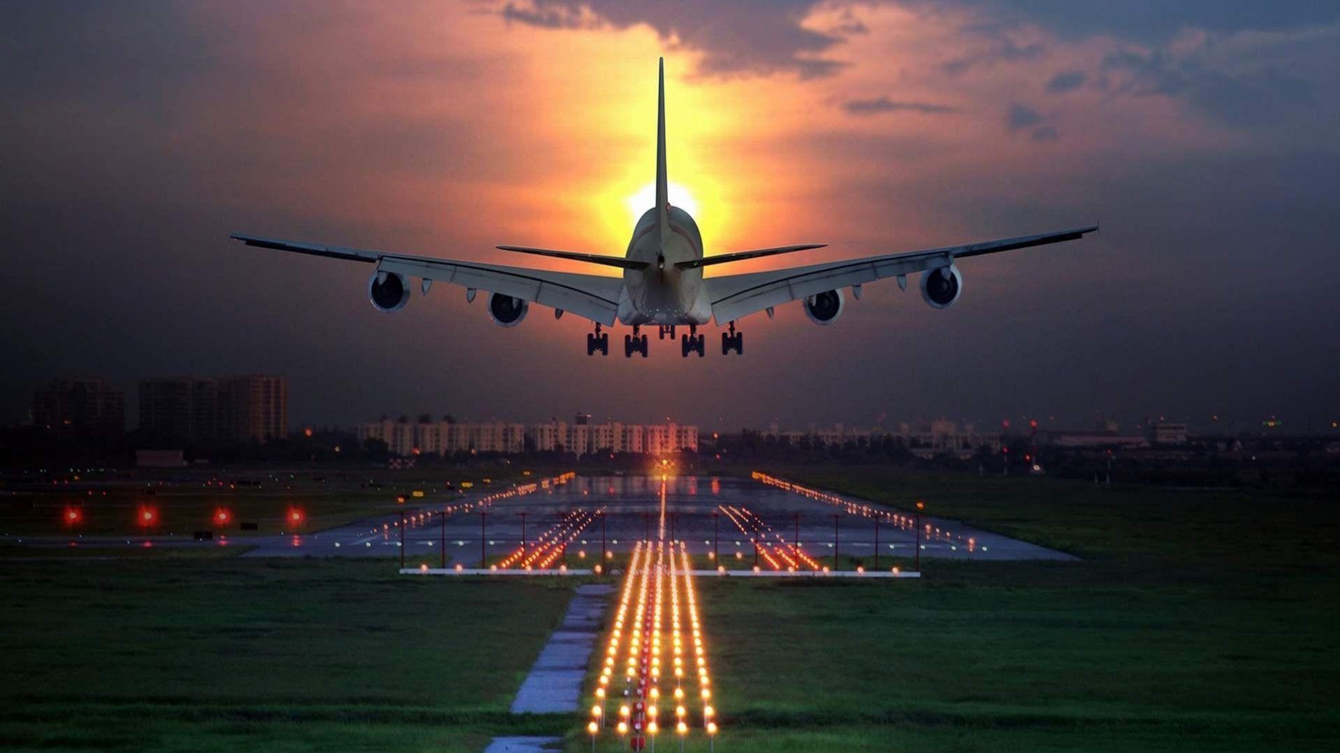 Big Airplane Landing On Runway At Night Wallpaper Big Airplane