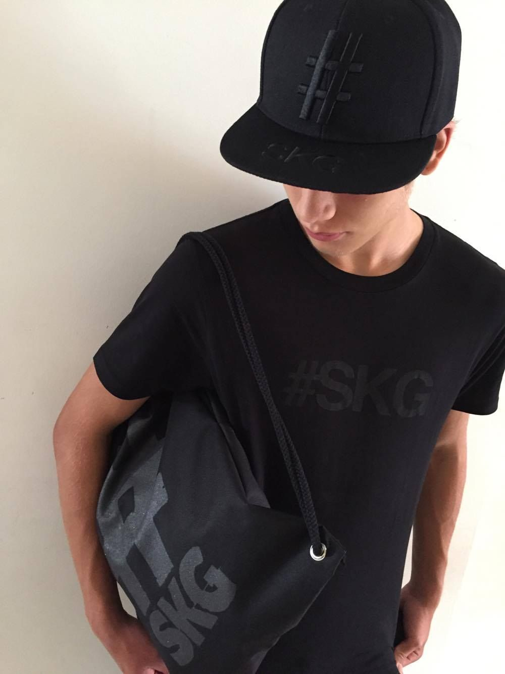 5cec252162e All-black  SKG hat