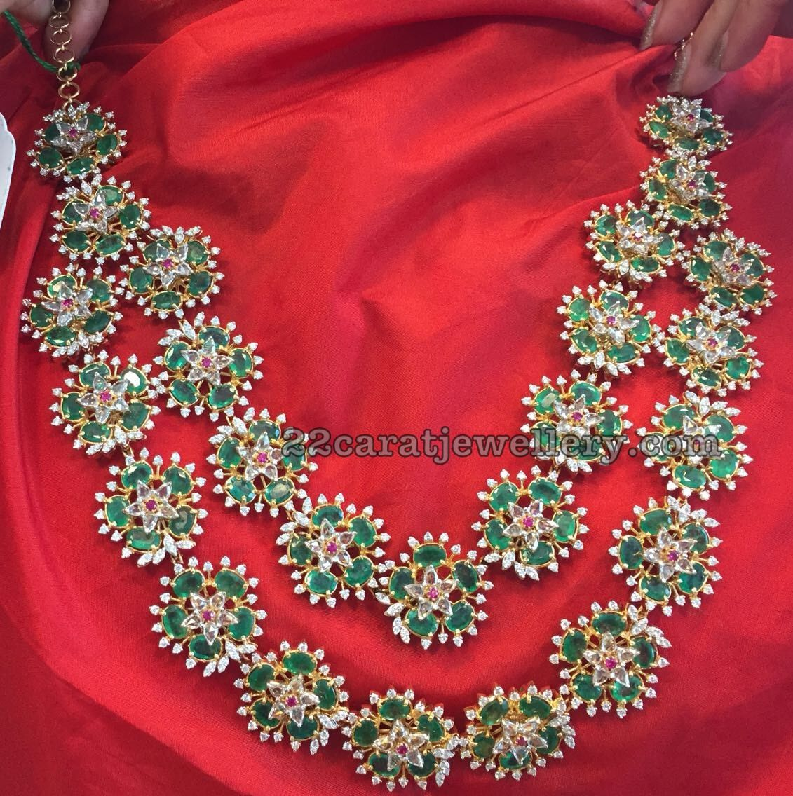 Small pearls necklace with lakshmi pendant earrings floral designs