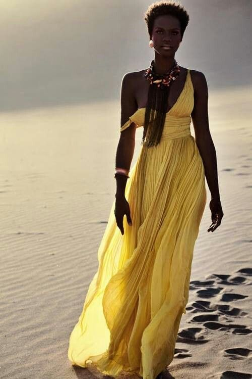 Example of yet another beautiful black queen.love the hair and the dress!